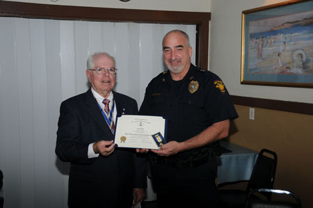 West Columbia Police Chief Paul Odin receives the Law Enforcement Commendation Award from President Win Avera Apr 2017